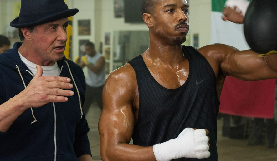 "This photo provided by Warner Bros. Pictures shows Michael B. Jordan, right, as Adonis Johnson and Sylvester Stallone as Rocky Balboa in Metro-Goldwyn-Mayer Pictures', Warner Bros. Pictures' and New Line Cinema's drama ""Creed,"" a Warner Bros. Pictures release. The movie opens in U.S. theaters on Nov. 25, 2015. (Barry Wetcher/Warner Bros. Pictures via AP)"