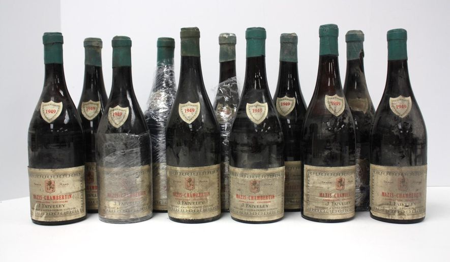 Eleven 750ml bottles of 1949 J. Faiveley Mazis Chambertin are up for auction through the U.S. Marshals Service after they were seized from convicted wine counterfeiter Rudy Kurniawan. (txauction.com)