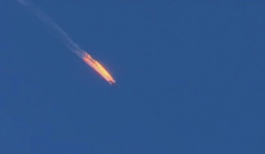 This frame grab from video by Haberturk TV shows a Russian warplane on fire before it crashed Tuesday. Turkey shot down the Russian aircraft, claiming it had violated Turkish airspace and ignored repeated warnings. Moscow denied that the plane had crossed the Syrian border into Turkish skies. (Associated Press)