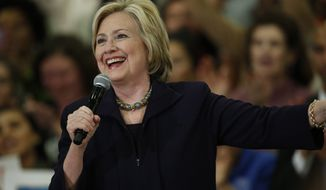 Democratic presidential candidate Hillary Rodham Clinton speaks during a rally Tuesday, Nov. 24, 2015, in a high school gymnasium in Denver. (AP Photo/David Zalubowski) ** FILE **