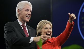 In this Oct. 24, 2015 file photo, former President Bill Clinton and his wife, Democratic presidential candidate Hillary Rodham Clinton, wave to supporters after the Iowa Democratic Party's Jefferson-Jackson fundraising dinner in Des Moines, Iowa. Clinton wants voters to know she is no friend of Wall Street. She and husband have made $35 million from 164 paid speeches to financial services, real estate and insurance companies since leaving the White House in 2001. (AP Photo/Charlie Neibergall, File)