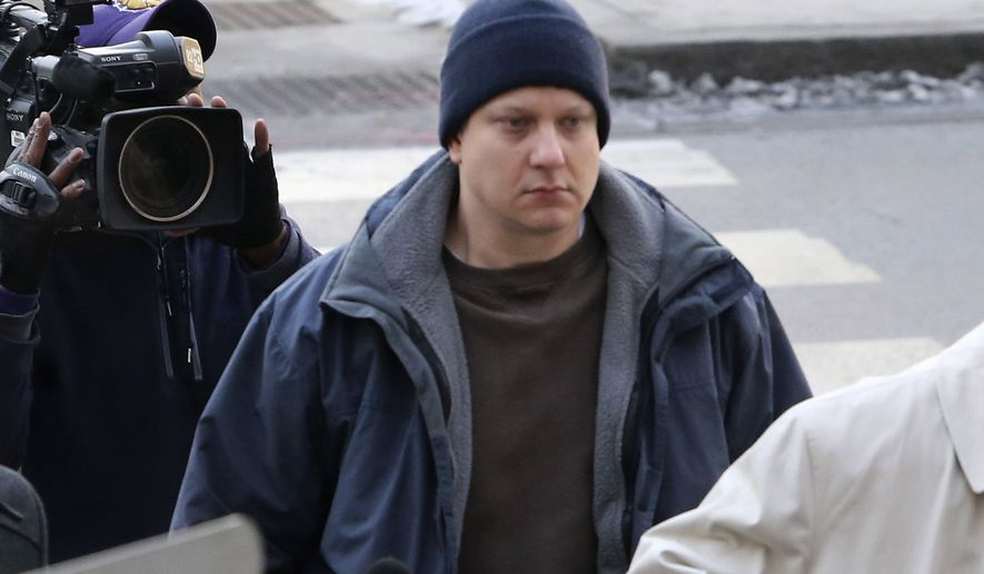 Chicago police officer Jason Van Dyke, accused of fatally shooting a black teenager, arrives at the Leighton Criminal Courthouse in Chicago on Tuesday, Nov. 24, 2015. Van Dyke was charged with first degree murder in the killing of 17-year-old Laquan McDonald. (Antonio Perez/Chicago Tribune via AP)MANDATORY CREDIT, CHICAGO SUN-TIMES OUT, DAILY HERALD OUT, NORTHWEST HERALD OUT, DAILY CHRONICLE OUT, THE HERALD-NEWS OUT, THE TIMES OF NORTHWEST INDIANA OUT, TV OUT, MAGS OUT, NO SALES