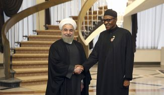 Iranian President Hassan Rouhani, left, shakes hands with Nigerian President Muhammadu Buhari prior to their meeting in Tehran, Iran, Tuesday, Nov. 24, 2015. (AP Photo/Vahid Salemi)