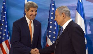 Israel's Prime Minister Benjamin Netanyahu, right, shakes hands with US Secretary of State John Kerry during a meeting at the Prime Minister's Office, in Jerusalem, Tuesday, Nov. 24, 2015. (Atef Safadi/Pool Photo via AP)