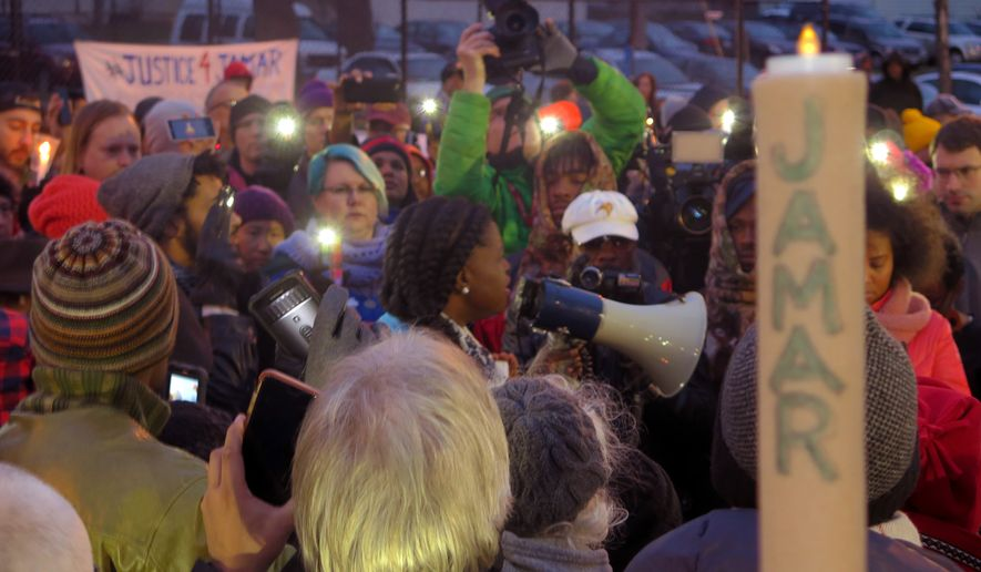 This Nov. 20, 2015, file photo shows Minneapolis NAACP leader Nekima Levy-Pounds speaking at a prayer vigil n Minneapolis. Five people have been shot near the site of an ongoing protest over the fatal shooting of a black man by a police officer, a Minneapolis Police Department spokesman said. (AP Photo/Greg Moore, File)