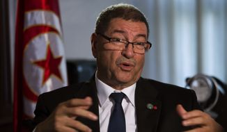 Tunisian Prime Minister Habib Essid speaks with The Associated Press during an interview ahead of a two-day conference in Madrid on combating the type of terrorism targeting foreign tourists that has hit his country twice over the last year, Spain, Tuesday, Oct. 27, 2015. (AP Photo/Emilio Morenatti) ** FILE **