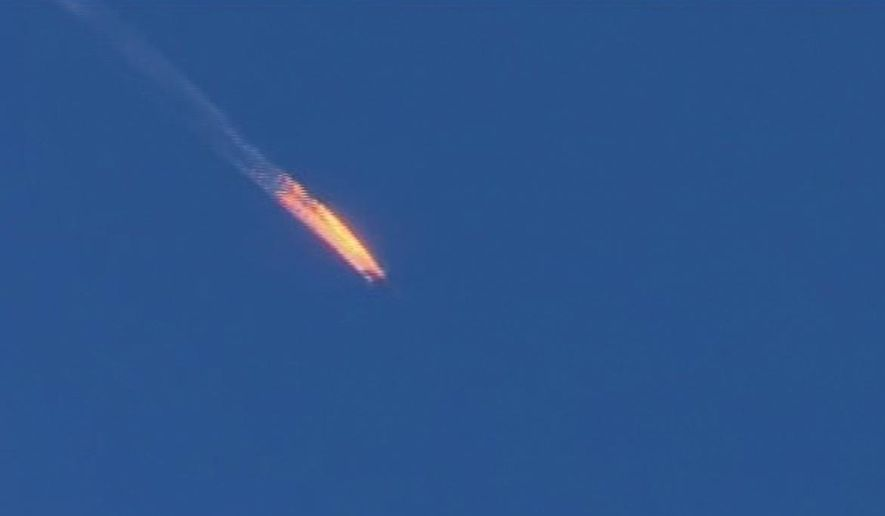 This frame grab from video by Haberturk TV, shows a Russian warplane on fire before crashing on a hill as seen from Hatay province, Turkey, Tuesday, Nov. 24, 2015. Turkey shot down the Russian warplane Tuesday, claiming it had violated Turkish airspace and ignored repeated warnings. Russia denied that the plane crossed the Syrian border into Turkish skies. (Haberturk TV via AP)
