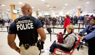 Americans say they personally are more watchful for terrorism this Thanksgiving weekend, a poll finds. At such travel hot spots as Hartsfield-Jackson Atlanta International Airport in Georgia, the extra presence of law enforcement is apparent. (associated press)