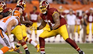 Washington Redskins tackle Trent Williams (71) against the Cleveland Browns linebacker Scott Solomon (54) during an NFL preseason football game, Thursday, Aug. 13, 2015, in Cleveland. (AP Photo/Ron Schwane)