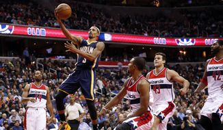 Indiana Pacers guard George Hill (3) drives to the basket with Washington Wizards guard Gary Neal (14), guard Ramon Sessions (7), forward Kris Humphries (43) and forward Nene (42), from Brazil, nearby during the second half of an NBA basketball game, Tuesday, Nov. 24, 2015, in Washington. The Pacers won 123-106. (AP Photo/Alex Brandon)