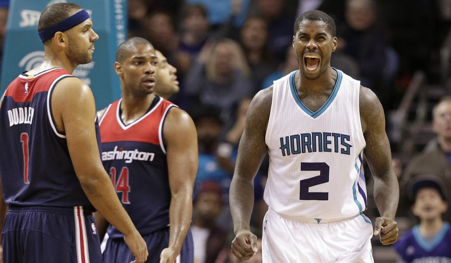 Charlotte Hornets' Marvin Williams (2) reacts after making a basket against the Washington Wizards and being fouled in the second half of an NBA basketball game in Charlotte, N.C., Wednesday, Nov. 25, 2015. The Hornets won 101-87. (AP Photo/Chuck Burton)