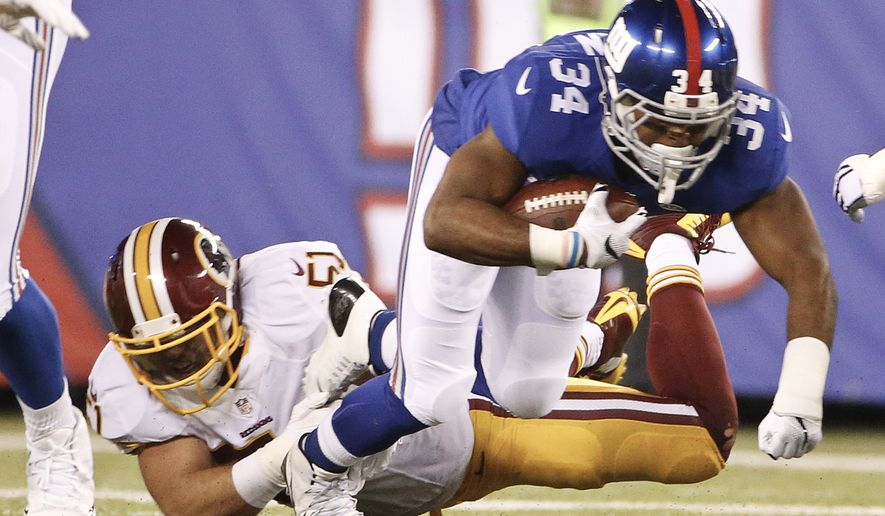 Washington Redskins inside linebacker Will Compton (51) tackles New York Giants' Shane Vereen (34) during the first half an NFL football game Thursday, Sept. 24, 2015, in East Rutherford, N.J. (AP Photo/Kathy Willens)