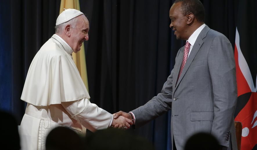 Pope Francis is greeted by Kenya's President Uhuru Kenyatta upon his arrival at Nairobi's State House, Wednesday, Nov. 25, 2015. Pope Francis is in Africa for a six-day visit that is taking him to Kenya, Uganda and the Central African Republic, which is torn by fighting between Christians and Muslims. (AP Photo/Andrew Medichini)