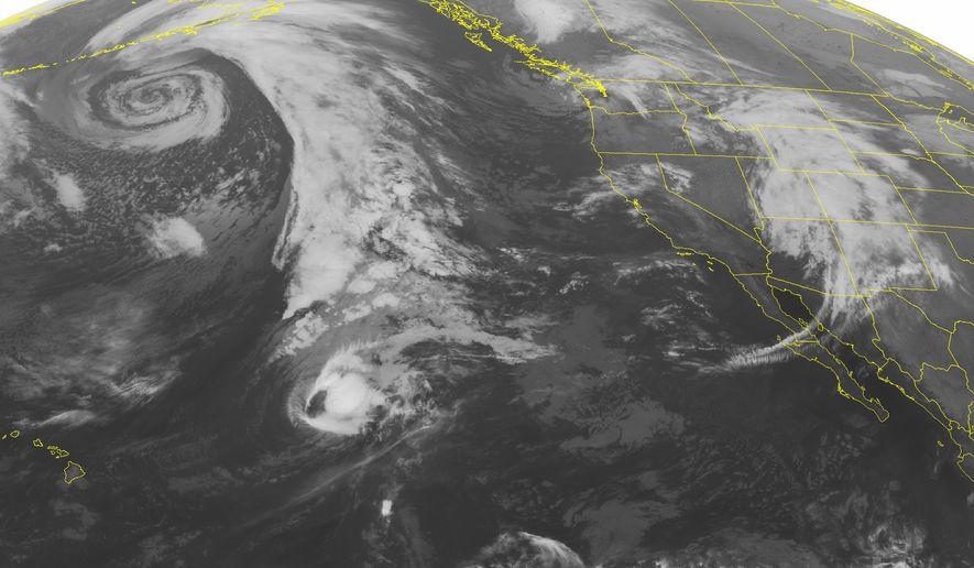 This NOAA satellite image taken Monday, Oct. 26, 2015, at 01:00 AM EDT shows weakening Hurricane Olaf well east of Hawaii. (NOAA/Weather Underground via AP) ** FILE **