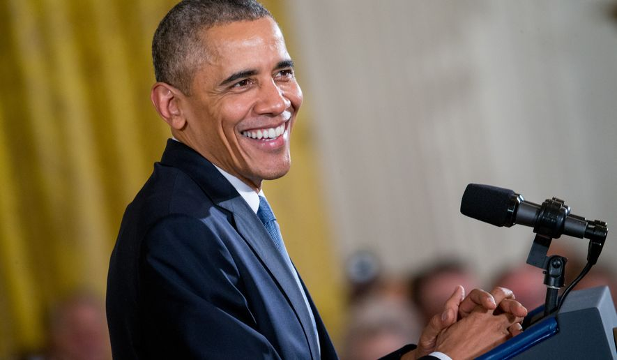 President Obama smiles during a Presidential Medal of Freedom ceremony in the East Room at the White House on Nov. 24, 2015. (Associated Press)