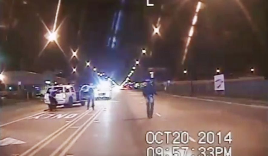 In this Oct. 20, 2014, frame from dash-cam video provided by the Chicago Police Department, Laquan McDonald, right, walks down the street moments before being shot by Officer Jason Van Dyke in Chicago. Van Dyke, who shot McDonald 16 times, was charged with first-degree murder Tuesday, Nov. 24, 2015. (Chicago Police Department via AP)