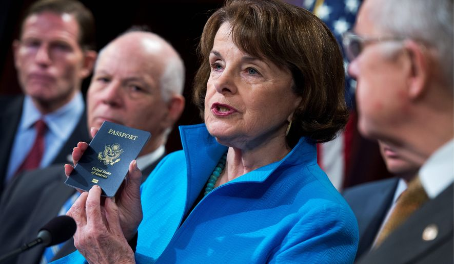 """Sen. Dianne Feinstein of California, the top Democrat on the Senate Select Committee on Intelligence, shows her passport during a news conference about closing loopholes in the Visa Waiver Program. Citing the """"soft underbelly of our national security policies,"""" she and other senators are writing a bill that would require anyone who has visited Syria or Iraq in the past five years to have passports with e-chips. (Associated Press)"""