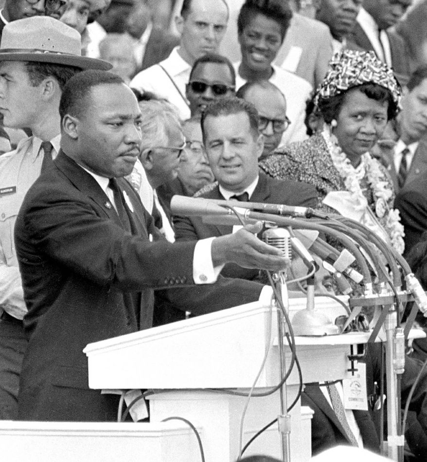 """The Rev. Martin Luther King Jr., gestures during his """"I Have a Dream"""" speech as he addresses thousands of civil rights supporters gathered in front of the Lincoln Memorial for the March on Washington for Jobs and Freedom in Washington, D.C., Aug. 28, 1963. (AP Photo)"""