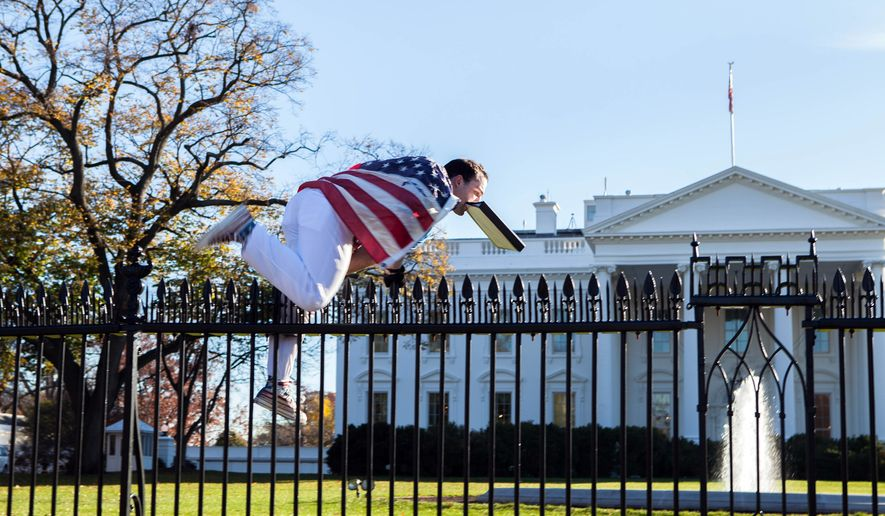 Joseph Caputo, 22, of Stamford, Connecticut, jumps a fence at the White House on Thursday, Nov. 26, 2015, in Washington. (Vanessa Pena via Associated Press) ** FILE **