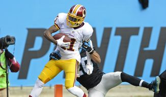 Washington Redskins' DeSean Jackson (11) runs into the end zone for a touchdown as Carolina Panthers' Kurt Coleman (20) defends in the first half of an NFL football game in Charlotte, N.C., Sunday, Nov. 22, 2015. (AP Photo/Mike McCarn)