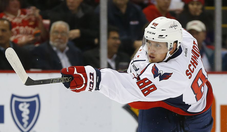 Washington Capitals defenseman Nate Schmidt (88) shoots against the Detroit Red Wings in the first period of an NHL hockey game Tuesday, Nov. 10, 2015 in Detroit. (AP Photo/Paul Sancya)