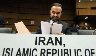 Iran's Ambassador to the International Atomic Energy Agency (IAEA), Reza Najafi, waits for the start of the IAEA board of governors meeting at the International Center, in Vienna, Austria, Thursday, Nov, 26, 2015. (AP Photo/Ronald Zak)