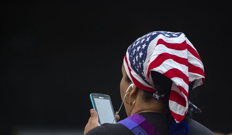 A woman uses her smartphone on a Wi-Fi public network in Havana, Cuba, Wednesday, in this file photo from Nov. 25, 2015.  (AP Photo/Desmond Boylan) **FILE**