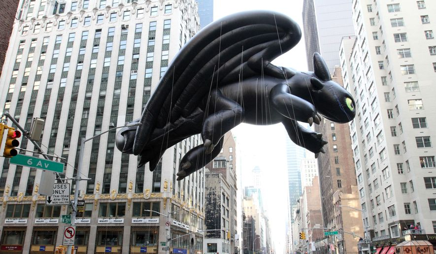 "The Toothless balloon, from ""How To Train Your Dragon"" makes its way down New York's Sixth Avenue during the Macy's Thanksgiving Day Parade Thursday, Nov. 26, 2015. (AP Photo/Tina Fineberg)"