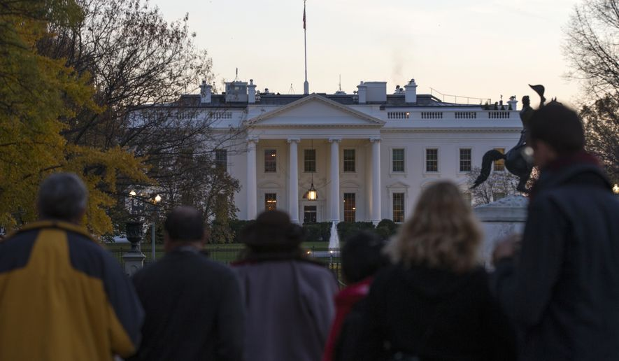 People gather outside the White House after the Secret Service arrested a man who was caught jumping the fence as President Obama and his family ate Thanksgiving dinner, on Thursday, Nov. 26, 2015, in Washington. (AP Photo/Evan Vucci) ** FILE **