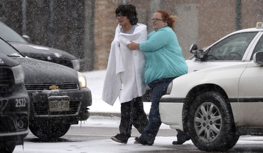 A person is escorted after reports of a shooting near a Planned Parenthood clinic Friday, Nov. 27, 2015, in Colorado Springs, Colo. A gunman opened fire at the clinic on Friday, authorities said, wounding multiple people. (Andy Cross/The Denver Post via AP) MAGS OUT; TV OUT; INTERNET OUT; NO SALES; NEW YORK POST OUT; NEW YORK DAILY NEWS OUT; MANDATORY CREDIT