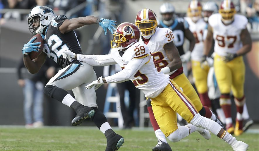Carolina Panthers' Jerricho Cotchery (82) tries to run away from Washington Redskins' Chris Culliver (29) and Dashon Goldson (38) during the first half of an NFL football game in Charlotte, N.C., Sunday, Nov. 22, 2015. The Panthers won 44-16. (AP Photo/Bob Leverone)
