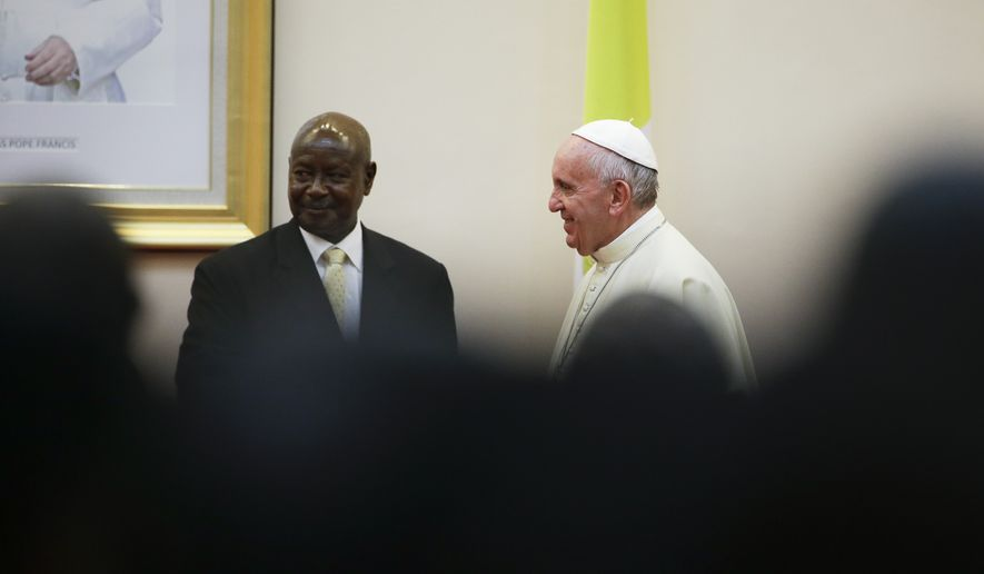 Pope Francis meets with Ugandan President Yoweri Kaguta Museveni at the State House, in Entebbe, Uganda, Friday, Nov. 27, 2015. Pope Francis is in Africa for a six-day visit that is taking him to Kenya, Uganda and the Central African Republic. (AP Photo/Andrew Medichini)