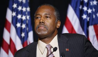 In this Nov. 16, 2015 photo, Republican presidential candidate Dr. Ben Carson speaks at a news conference in Henderson, Nev. Carson is making a post-Thanksgiving trip to visit Syrian refugees in Jordan this weekend. (AP Photo/John Locher)