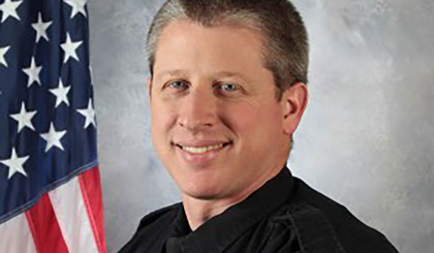 This photo provided by the University of Colorado at Colorado Springs shows Officer Garrett Swasey, who was killed in a shooting at a Planned Parenthood clinic in Colorado Springs, Colo., Friday, Nov. 27, 2015. (University of Colorado at Colorado Springs via AP)