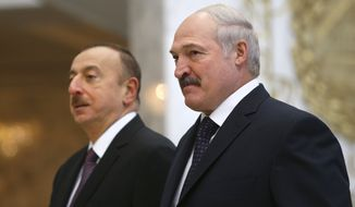 Belarusian President Alexander Lukashenko, right, and Azerbaijan President Ilham Aliyev pose for a photo in Minsk, Belarus, Saturday, Nov. 28, 2015. Aliyev arrived in Belarus for a two-day official visit. (AP Photo/Sergei Grits)