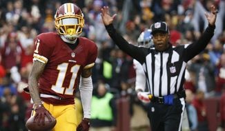 Washington Redskins wide receiver DeSean Jackson (11) carries the ball into the end zone for a touchdown during the first half of an NFL football game against the New York Giants in Landover, Md., Sunday, Nov. 29, 2015. (AP Photo/Alex Brandon)