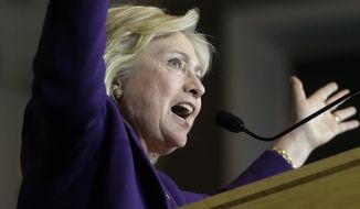 Democratic presidential candidate Hillary Clinton addresses an audience at a rally at Faneuil Hall, Sunday, Nov. 29, 2015, in Boston. (AP Photo/Steven Senne)