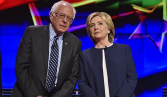 """Front-runner Hillary Rodham Clinton blamed """"low-level offenses that are primarily due to marijuana,"""" while Sen. Bernard Sanders said states should consider legalizing marijuana out of fairness. (Associated Press)"""