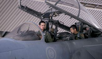 Saudi pilots involved in U.S.-led coalition airstrikes on Islamic State targets sit in the cockpit of a fighter jet in Saudi Arabia on Sept. 24. (Associated Press)