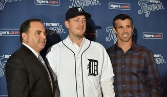 Detroit Tigers general manager Al Avila, left, pitcher Jordan Zimmermann and manager Brad Ausmus, right, pose for a photo after a news conference in Detroit, Monday, Nov. 30, 2015. Free agent Zimmermann has finalized a $110 million, five-year contract with the Detroit Tigers. (Robin Buckson/Detroit News via AP)