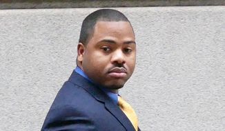 William Porter, one of six Baltimore city police officers charged in connection to the death of Freddie Gray, walks into a courthouse for jury selection in his trial, Monday, Nov. 30, 2015, in Baltimore. Porter faces charges of manslaughter, assault, reckless endangerment and misconduct in office. (Kevin Richardson/The Baltimore Sun via AP, Pool)