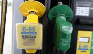Companies that offer higher ethanol blends can sell renewable identification numbers to those that provide only E0 gasoline to help them comply with the Environmental Protection Agency's fuel requirement of a 10 percent average. (Associated Press) ** FILE **