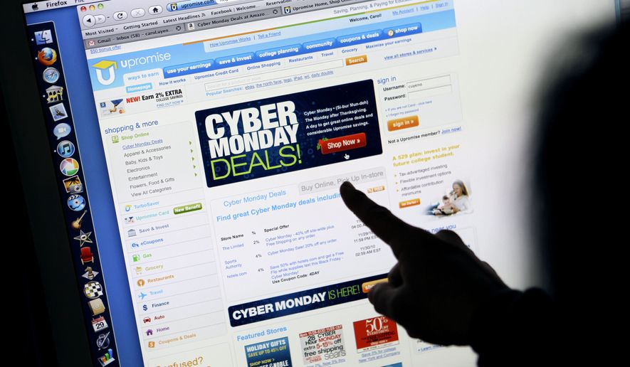 In this Monday, Nov. 29, 2010, file photo, a consumer looks at Cyber Monday sales on her computer at her home in Palo Alto, Calif. (AP Photo/Paul Sakuma, File)