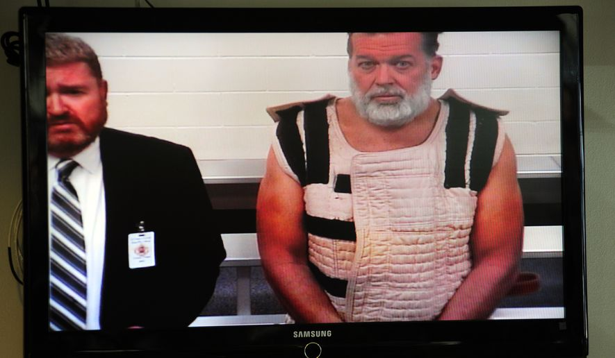Colorado Springs shooting suspect Robert Dear (right) appears via video before Judge Gilbert Martinez alongside public defender Dan King. (Associated Press)