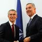 Montenegrin Prime Minister Milo Djukanovic (right) meets with NATO Secretary-General Jens Stoltenberg in Podgorica, Montenegro, in October. Despite its small size, Montenegro's NATO bid has already sparked an outsize reaction. (Associated Press) ** FILE **