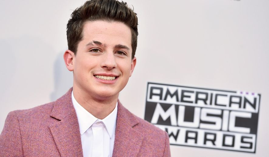 """FILE - In a Sunday, Nov. 22, 2015 file photo, Charlie Puth arrives at the American Music Awards at the Microsoft Theater, in Los Angeles. ABC announced Tuesday, Dec. 1, 2015 that Luke Bryan, Demi Lovato and Wiz Khalifa with Charlie Puth will help countdown to 2016 on """"Dick Clark's New Year's Rockin' Eve With Ryan Seacrest"""" in New York City's Times Square.(Photo by Jordan Strauss/Invision/AP, File)"""