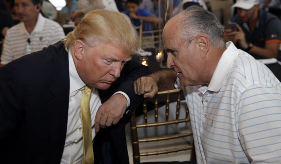Republican presidential candidate Donald Trump (left) talks with former New York City Mayor Rudy Giuliani at a fundraising event in the Bronx borough of New York on July 6, 2015. (Associated Press) **FILE**