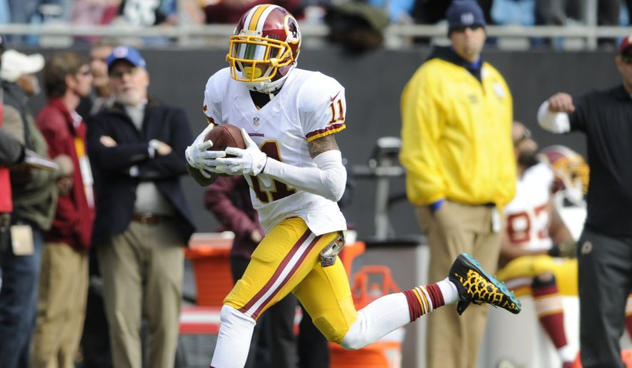 Washington Redskins' DeSean Jackson (11) runs for a topcudhwon after a catch against the Carolina Panthers in the first half of an NFL football game in Charlotte, N.C., Sunday, Nov. 22, 2015. (AP Photo/Mike McCarn)