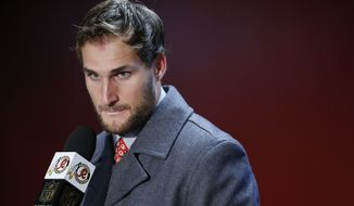 Washington Redskins quarterback Kirk Cousins listens to a question during a post-game interview after an NFL football game against the New York Giants in Landover, Md., Sunday, Nov. 29, 2015. The Washington Redskins defeated the New York Giants 20-14. (AP Photo/Alex Brandon)