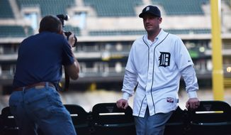 Detroit Tigers pitcher Jordan Zimmermann poses for a photo for team photographer Mark Cunningham in Detroit, Monday, Nov. 30, 2015. Free agent Zimmermann has finalized a $110 million, five-year contract with the Detroit Tigers. (Robin Buckson/Detroit News via AP)